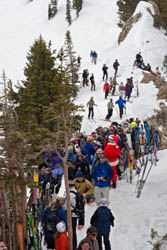 Skiers line the ridgeline above Alf's High Rustler