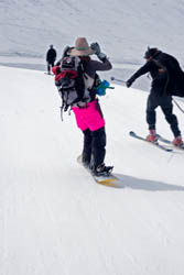 Even at Alta, skiers are willing to help out a snowboarder in need of propulsion