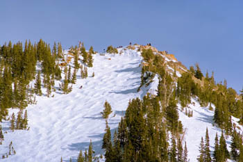 Blue skies above and sunny bumps below keep the diehards atop High Rustler well into the evening